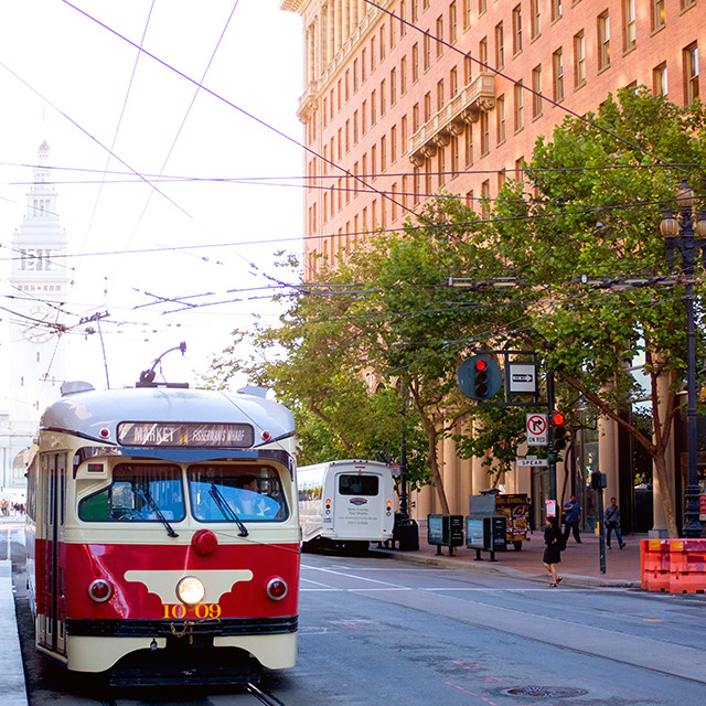San Francisco Market Street trolley drives by the office building of Visa One Market office.