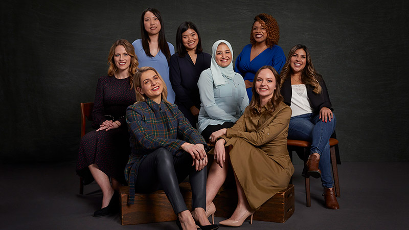 women entrepreneurs posed together and seated
